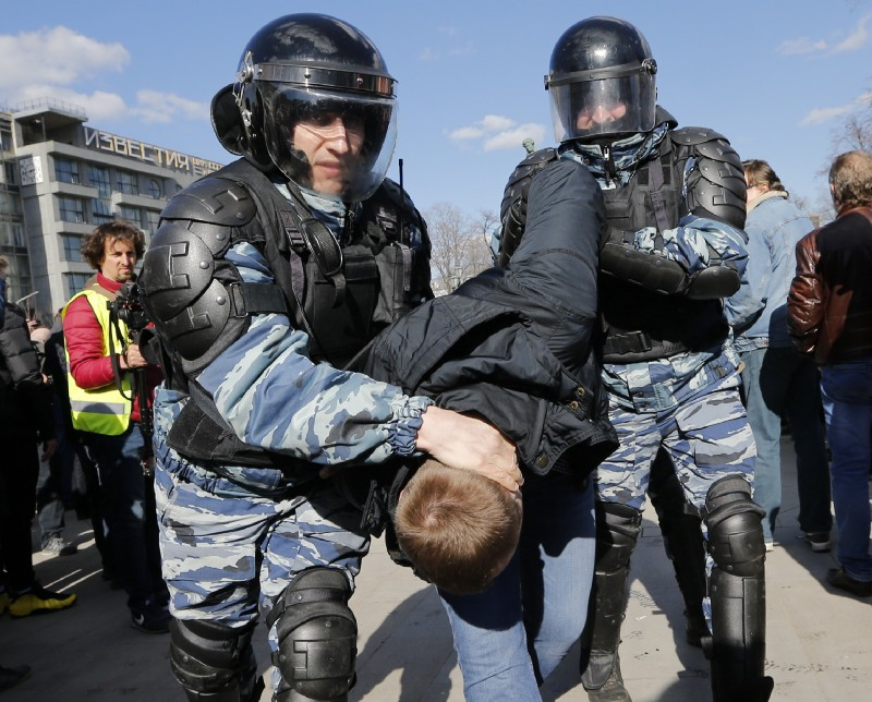 Russian security forces detain a protester in Moscow on Sunday. CREDIT: AP Photo/Alexander Zemlianichenko.