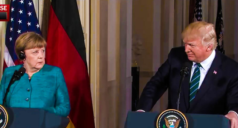 German Chancellor Angela Merkel looks on as President Donald Trump accuses a German reporter of engaging in 'fake news.' (Screen cap).
