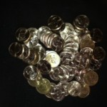 Pile of de-godded dollar coins