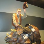 Edwin Attempts to Ride Dino at Creation Museum