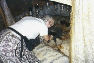 Helen Kagin Touching Birthplace of the Baby Jesus in Bethlehem