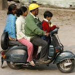 A family rides on scooter in Siliguri