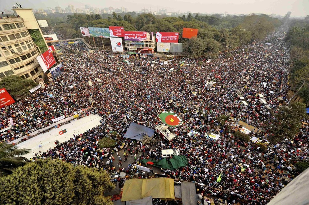 People attend mass demonstration at Shahbagh intersection, in Dhaka