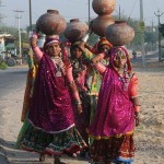 women_carrying_water