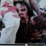 An image from a mobile phone apparently showing Col Muammar Gaddafi wounded. Origin unknown.