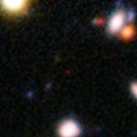 The red speck at the centre of this very deep image from the ESO Very Large Telescope shows the galaxy NTTDF-474, seen when the Universe was only 820 million years old. It is one of the most distant ever to have had its distance measured accurately, and is one of five that have been used to chart the timeline of the reionisation of the Universe about 13 billion years ago. Image: ESO/ L. Pentericci.