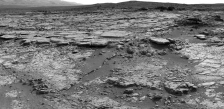 "The sinuous rock feature in the lower center of this mosaic of images recorded by the NASA Mars rover Curiosity is called ""Snake River."" Image taken Dec. 20, 2012. CREDIT: NASA/JPL-Caltech"
