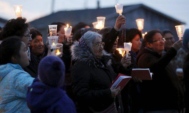 People take part in a candlelight vigil Attawapiskat. Photograph: Chris Wattie/Reuters