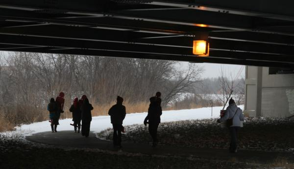 Mary Annette Pember Supporters in the Sing Our Rivers Red march carry signs as they walk under the Veterans Bridge along the Red River in Fargo, North Dakota. The bridge underpass has been the site of several sexual assaults of indigenous women.