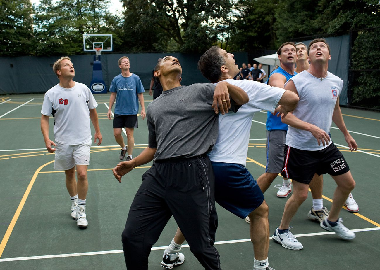 Oct 2009 – The president jostles with congressmen during a basketball game at the White House.