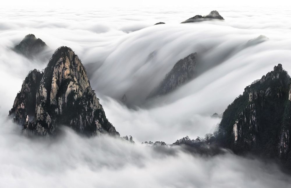 This image was captured very early in the morning after climbing Yellow Mountain at 3 am and waiting for few hours in the cold and wind at -4 degrees. No HDR and no Photoshop was used for the effect of this image, everything is 100% natural. The magic of the nature did its work and I have been lucky, © Thierry Bornier / National Geographic Travel Photographer of the Year Contest.