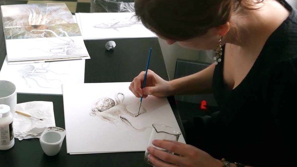 Esther van Hulsen at work on an octopus drawing using 95 million-year-old ink. Photo by Stian Steinsli