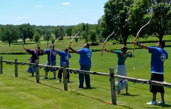 At the close of the ceremony, a 21-arrow salute was given by an archery team of students from Nebraska Indian Community College.