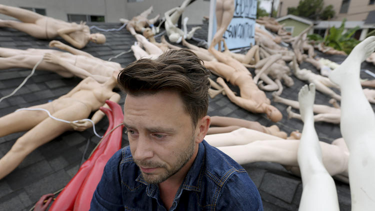 Artist ChadMichael Morrisette sits on the roof of his West Hollywood home where he has placed 50 mannequins, as a way of dealing with his grief and expressing his feelings over the mass killing in Orlando. (Mark Boster/ Los Angeles Times)