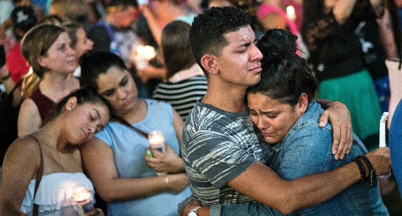 People embrace during a vigil in Orlando for the mass shooting victims at the Pulse nightclub (AFP Photo/Brendan Smialowski)