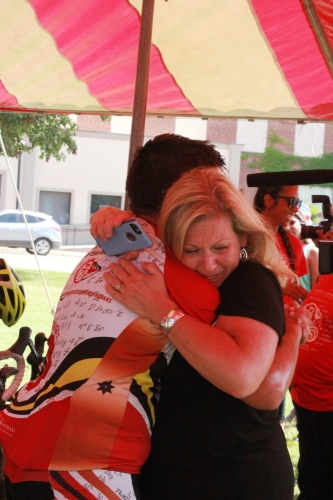 2016 Remember the Removal Bike Ride participant and Eastern Band of Cherokee Indians citizen Jack Cooper hugs his mother Jill after completing the 950-mile bike ride. (Courtesy Cherokee Nation)
