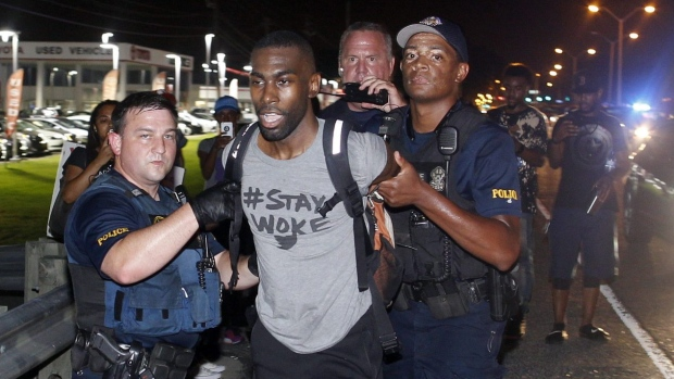 Police arrest activist DeRay McKesson during a protest along a major road that passes in front of the Baton Rouge Police Department headquarters. (Max Becherer/Associated Press)