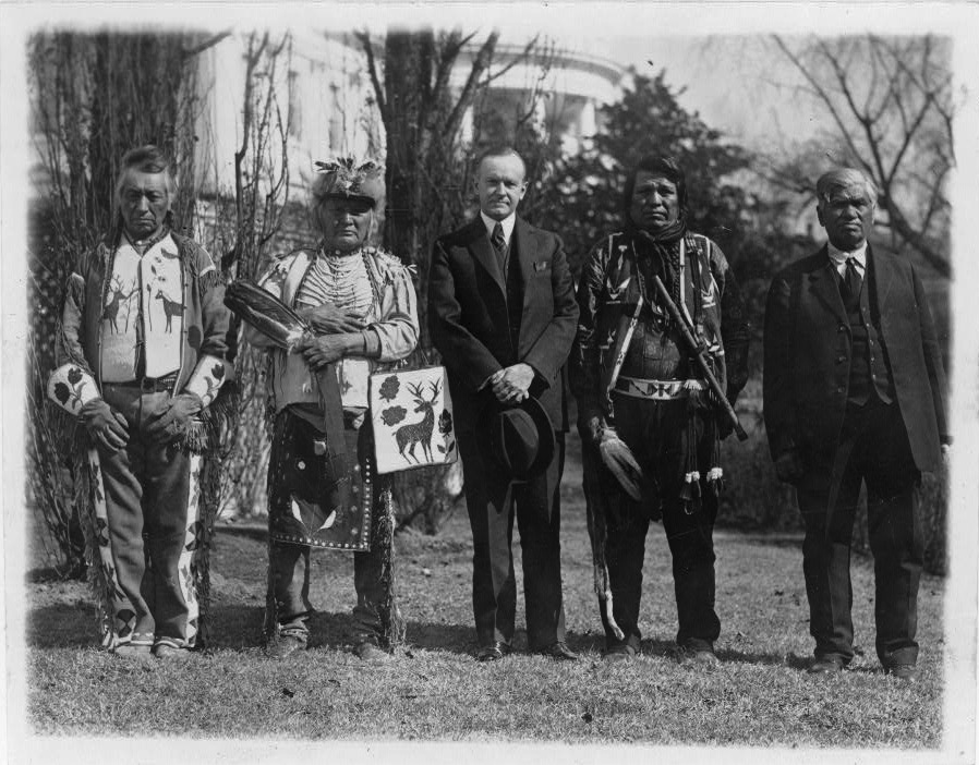 President Calvin Coolidge with four Osage Indians after Coolidge signed the bill granting Indians full citizenship. (Library of Congress Prints and Photographs Division, Washington, D.C.)