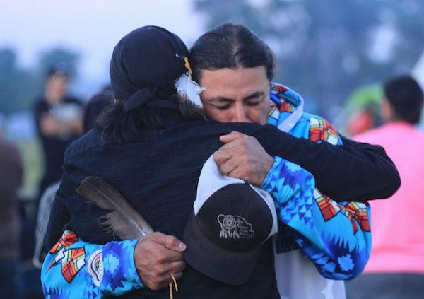 San Carlos Apache Tribe council member Wendsler Nosie Sr. embraces Standing Rock Sioux Tribe David Archambault II at the Camp of the Sacred Stones near the Standing Rock reservation, where Nosie came to offer support and prayers to those taking a stand against the Dakota Access oil pipeline. The Apache Stronghold has been fighting for more than a decade to stop the takeover of sacred Oak Flat for copper mining by Rio Tinto. Apache Stronghold is one of nearly 90 tribes that have expressed support.