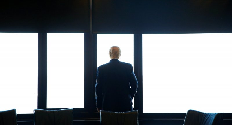 Republican U.S. presidential nominee Donald Trump looks out at Lake Michigan during a visit to the Milwaukee County War Memorial Center in Milwaukee, Wisconsin August 16, 2016. REUTERS/Eric Thayer.