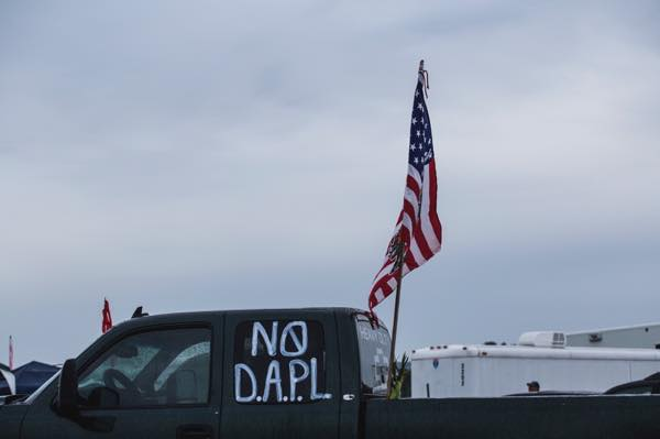 "Many camp participants adorned their trucks with tribal flags and messages of hope, such as the popular phrase ""No DAPL"" meaning ""No Dakota Access Pipeline."" (Photo: Thosh Collins)"
