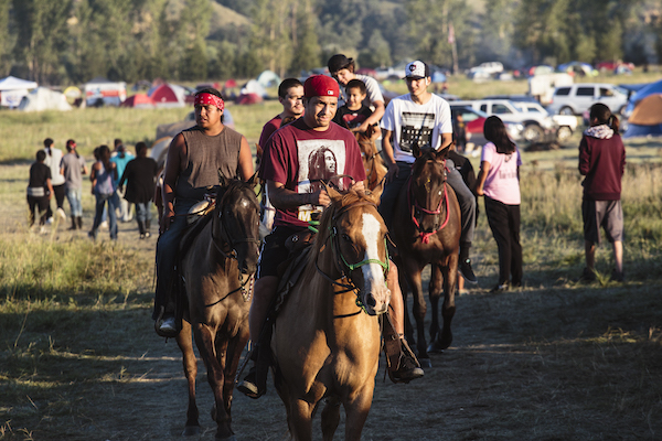 On Sunday, teenagers from the Cannon Ball community - the town nearest the prayer camp sites - ride around camp on bareback horses in solidarity with local water protectors. The boys are demonstrating nonviolent warrior values of strength and protection. (Photo: Thosh Collins).