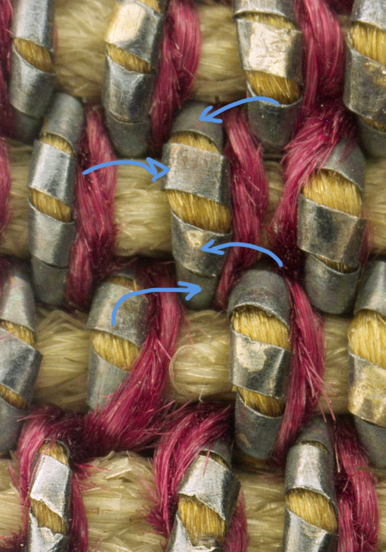 The Metal threads are made of very thin strips of gilt silver wrapped around yellow dyed silk.