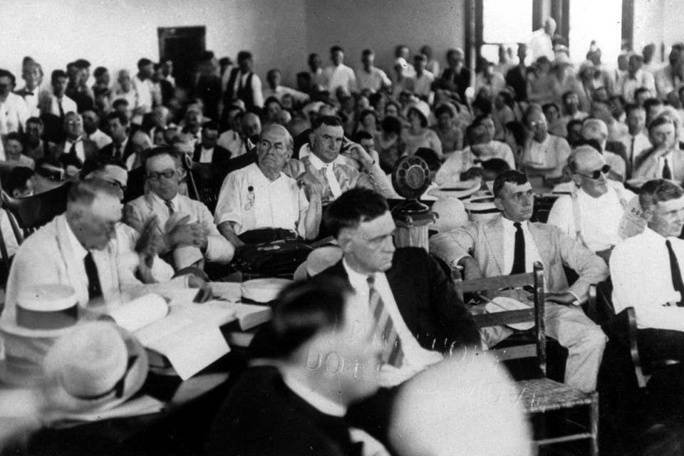 FILE - This July 15, 1925 file photo shows attorney William Jennings Bryan, sitting center behind the microphone during a radio broadcast of the landmark trial of John Thomas Scopes in Dayton, Tenn. The controversial trial between religion and state determined how evolution would be taught in schools. Scopes, a high school biology teacher, was found guilty of teaching evolution and fined. The town hosts an annual festival, this year July 20-21, marking the anniversary of the famous trial about the teaching of evolution in public schools. (AP Photo, file)