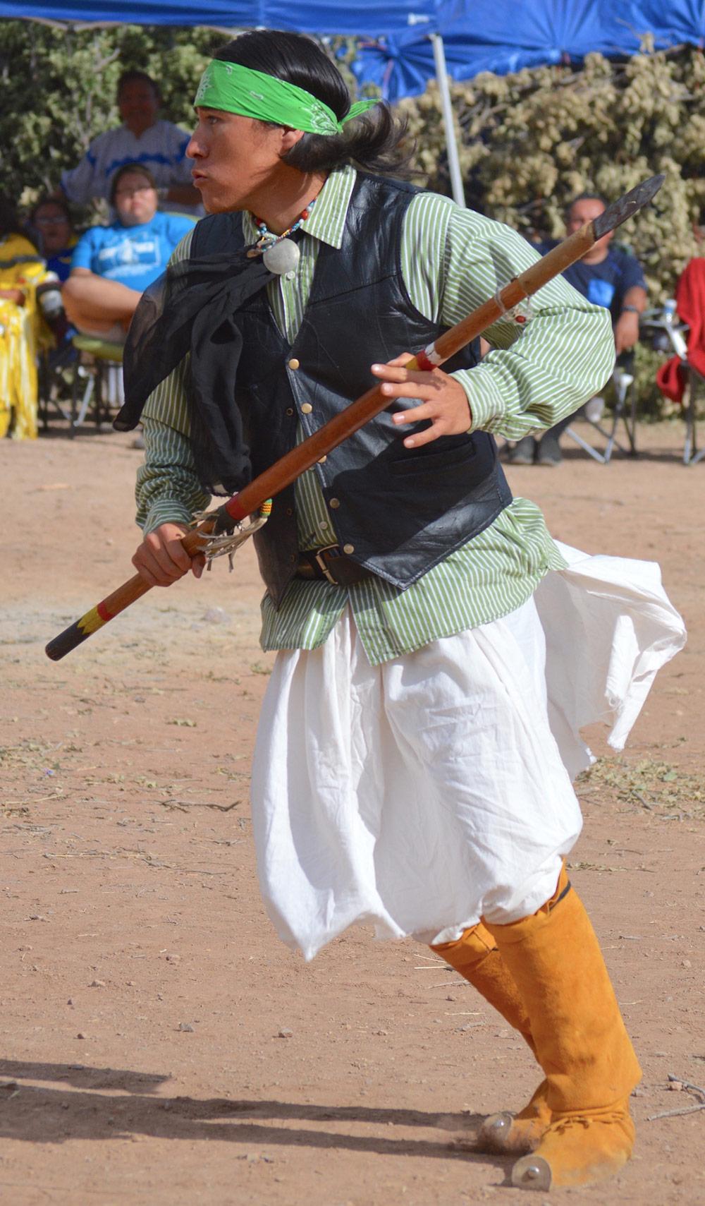 Apache Social Dancer Guy Narocomy (Comanche, Cuddo, Seminole, Chirichan, Lippan Apache) dances at the Apache puberty rites. (Photo by Kerri Cottle)