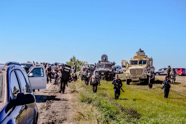Courtesy Sacred Stone Camp Police raise weapons and approach unarmed water protectors at a peaceful action on September 28, 2016
