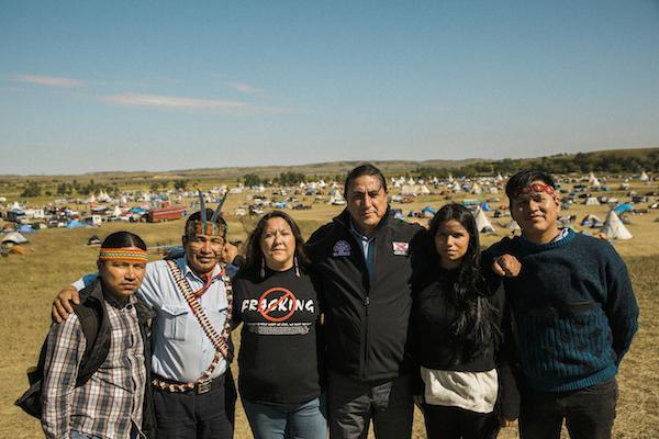 Left to Right: Eriberto Gualinga (Sarayaku), Franco Viteri (Sarayaku), Kandi Mossett (IEN), David Archambault II (Standing Rock Sioux Tribal Chairman), Nina Gualinga (Sarayaku), and Leo Cerda (Kichwa, on Amazon Watch staff). Courtesy Josue Rivas/Indigenous Rising.