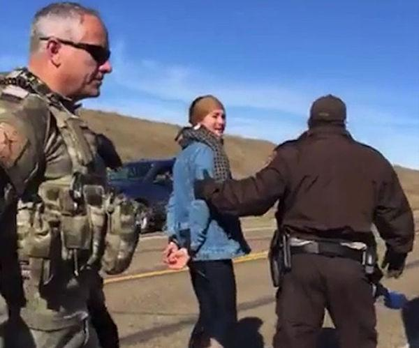 Actress Shailene Woodley being led away in handcuffs after standing with the water protectors at a Dakota Access oil pipeline construction site on Monday October 10. Via Facebook.