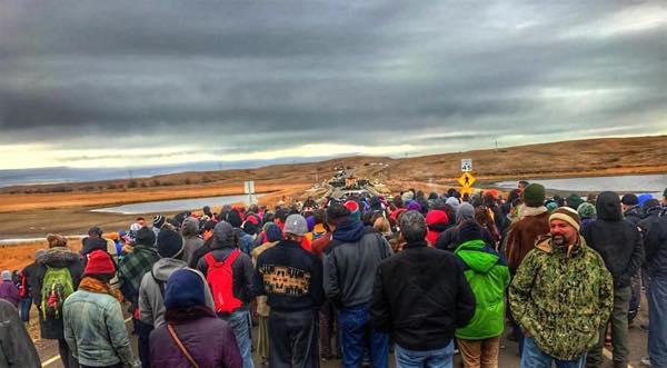 Eugene Tapahe. Hundreds of water protectors gathered along Highway 1806 for prayer as Chief Arvol Looking Horse carried the Pipe to negotiate peace with law enforcement.