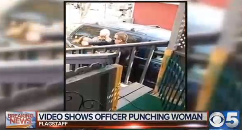 Cop punches woman in the face (CBS/Screengrab).