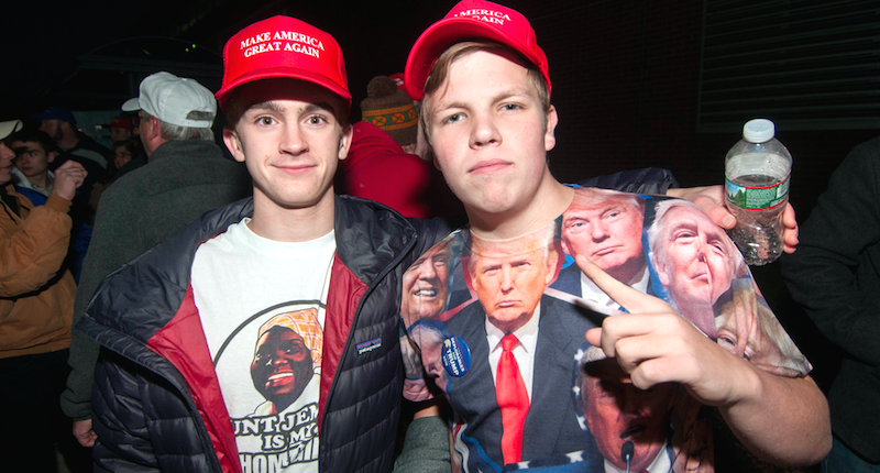 Two young Donald Trump fans wait to get inside the Trump rally in Manchester, N.H., Nov. 7, 2016 (Andrew Cline/Shutterstock).