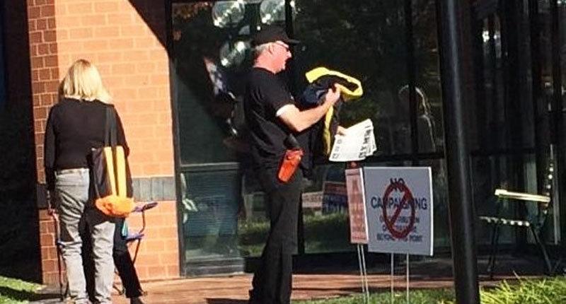 Virginia man outside polling location carrying a handgun_ -- Image via Twitter.