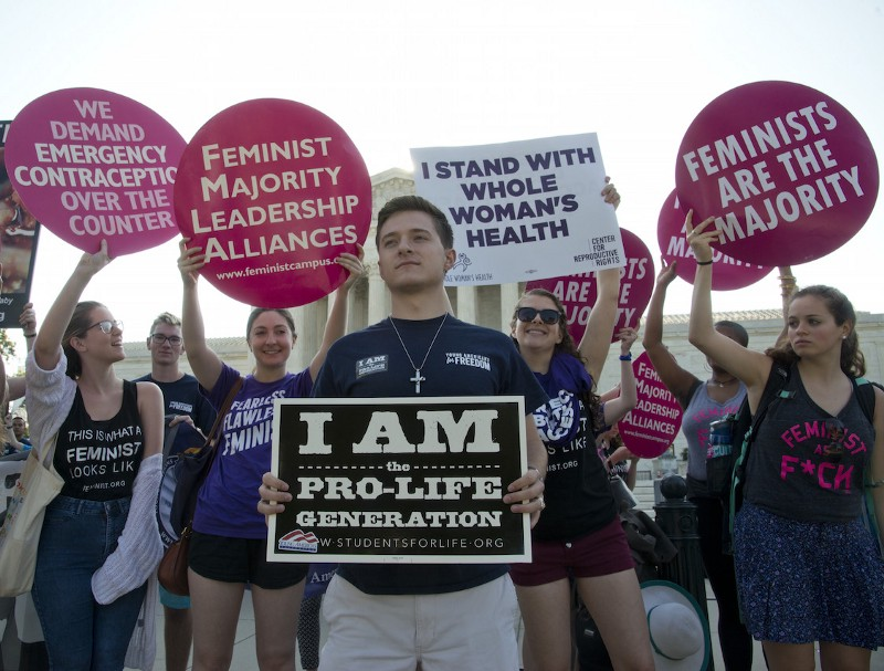 USA-Pr0-Life and Pro-Choice advocates protest at the Supreme Court in Washington DC in anticipation of the Supreme Court 's ruling on free access to abortion. CREDIT: AP/Patsy Lynch.
