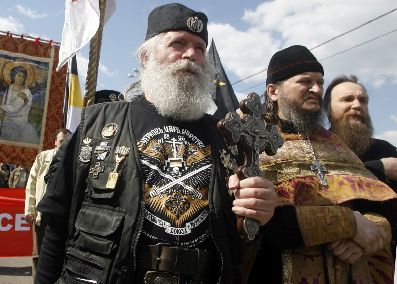 Alexander Dugin, the leader of the Eurasian Movement (far right) takes part in a Russian nationalists' rally in support of Serbia in Moscow, Russia, Sunday, April 27, 2008. CREDIT: AP Photo/Mikhail Metzel.