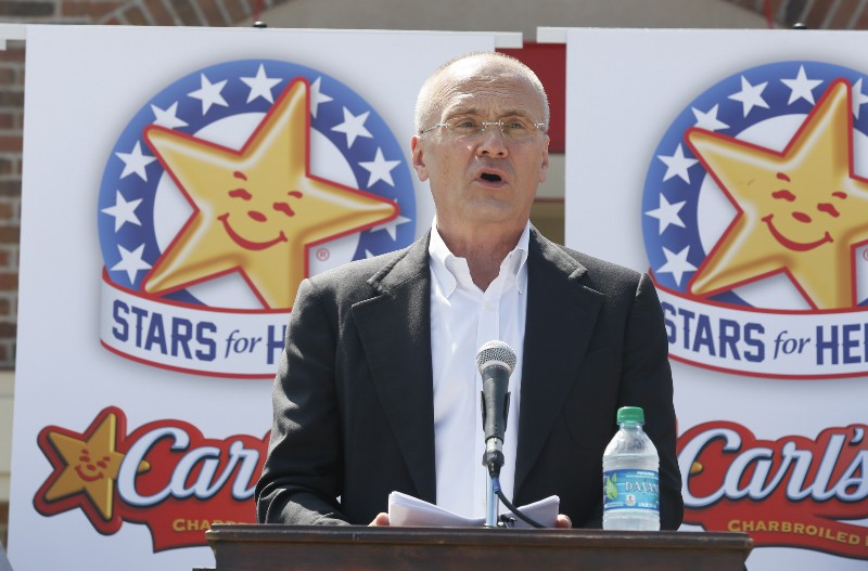 *CKE Restaurants CEO Andy Puzder speaks at a news conference on Wednesday, August 6, 2014 in Austin, Texas. CREDIT: Jack Plunkett/AP Images.