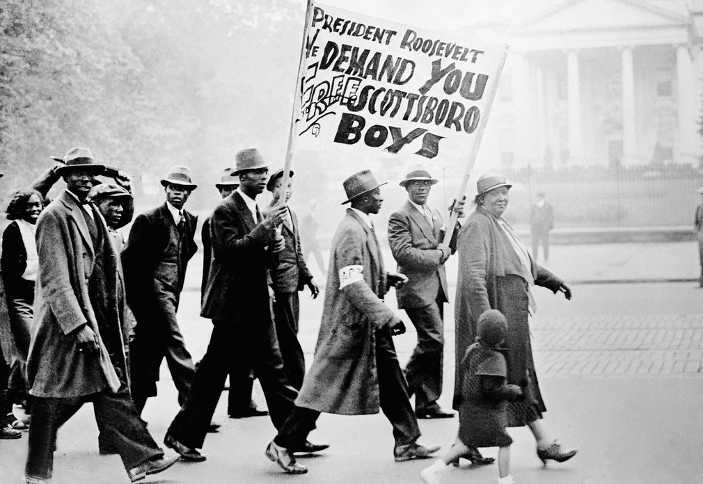 Protesters march on the White House in 1933 to demand a fair trial for the 'Scottsboro Boys'. This case – in which a group of black teenagers was convicted by an all-white jury of raping a white woman, then sentenced to death – is considered a grave miscarriage of justice Photograph: Gamma-Keystone via Getty Images.