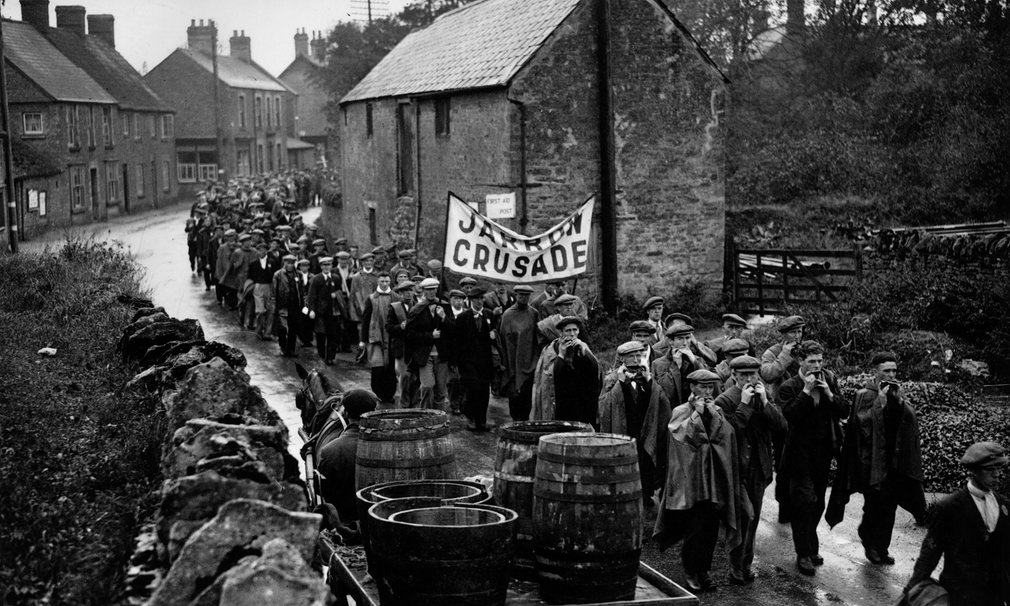 The Jarrow marchers pass through the village of Lavendon, near Bedford, in October 1936. Two hundred men walked the 291 miles from Tyneside to London to deliver a petition for jobs to the government. Photograph: Getty Images.