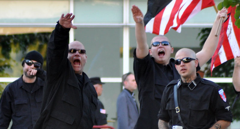 Members of the National Socialist Movement (Neo-Nazis) during a 2010 march to the Phoenix Federal building (John Kittelsrud/Flickr).
