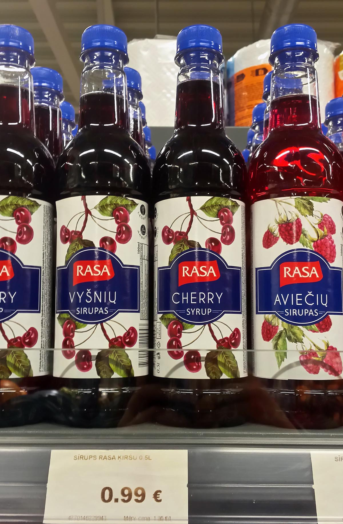 Cherry syrup in a grocery store.