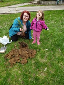 My daughter and I planting a tree.