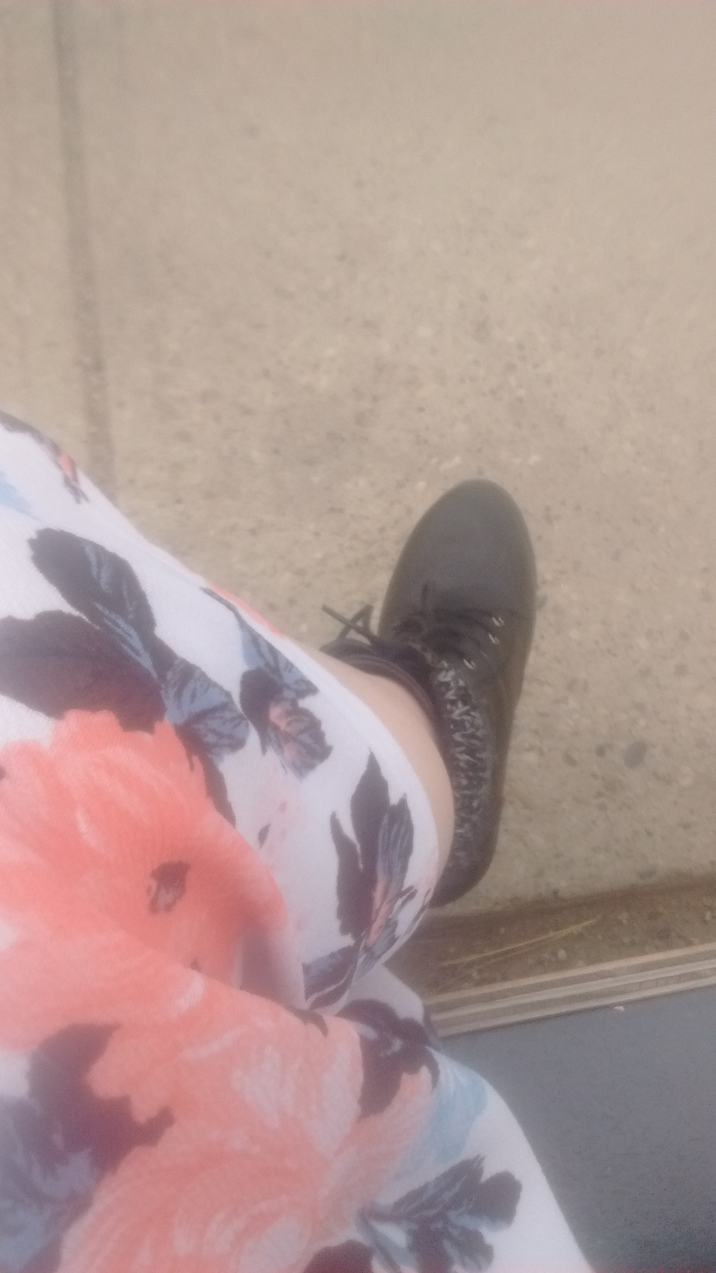 No flowery summer dress is complete without polished combat boots.