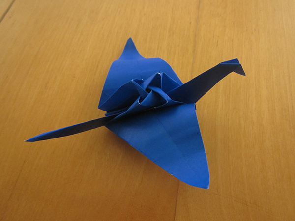 Shown: a paper crane, but the back of the crane is a four-petaled rose