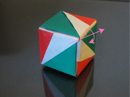 A cube with a single axis of rotation drawn in. This axis of rotation goes through the vertex facing the camera.