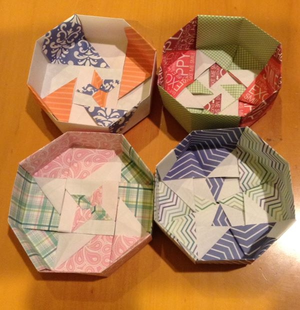 Four octagonal boxes (without covers)