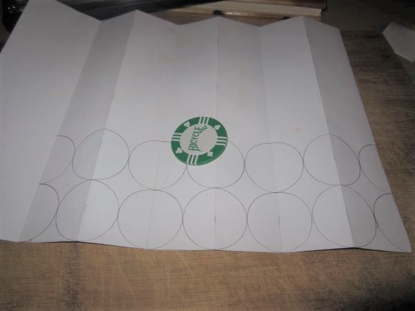 poker chip and circular outlines on paper