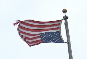 An American flag flies in the inverted position to signal distress.